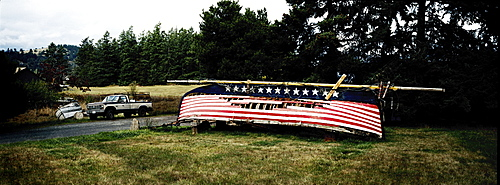 Upturned derelict boat with stars and stripes painted on hull, Washington state, United States of America, North America