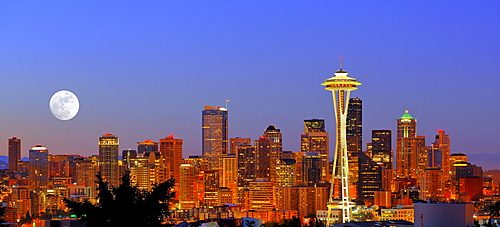 Night scene, skyline of the Financial District in Seattle with a full moon, Space Needle, Columbia Center, formerly known as Bank of America Tower, Washington Mutual Tower, Two Union Square Tower, Municipal Tower, formerly Key Tower, U.S. Bank Center, Was