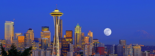 Panoramic night scene, skyline of the Financial District in Seattle with a full moon, Space Needle, Columbia Center, formerly known as Bank of America Tower, Washington Mutual Tower, Municipal Tower, formerly Key Tower, U.S. Bank Center, Washington, Unite
