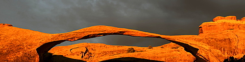 Panorama view, Landscape Arch at sunrise and approaching thunderstorm, Arches National Park, South West, USA
