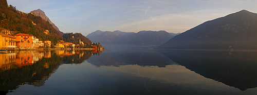 San Mamete reflected in Lake Lugano, Ticino, Switzerland, Italy, Europe