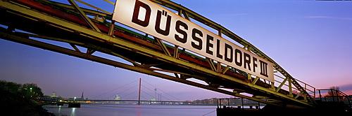 "Pier on the Rhine with ""Duesseldorf"" lettering in the evening light, Duesseldorf on the Rhine, North Rhine-Westphalia, Germany, Europe"
