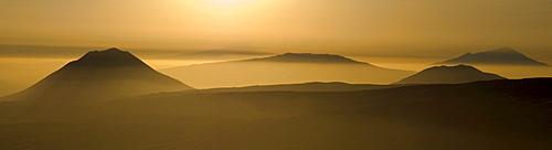 View from Ngorongoro Crater Highlands on Ol Donyo Lengai, Gelai, Keremassi and Mount Meru volcanoes, East African Rift, Tanzania, Africa