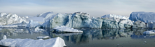 Icebergs in the midnight light, Disco Bay, West Greenland, Greenland