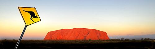 Panorama, kangaroo warning sign, Uluru, Ayers Rock at sunset, Uluru-Kata Tjuta National Park, Northern Territory, Australia