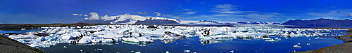 Glacial Lake Joekulsarlon, engl. glacial river lagoon, situated between the Skaftafell-National Park and Hoefn, with icebergs adrift, panoramic view, South Coast, Iceland, Europe
