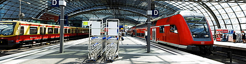 S-Bahn train meets Regional Express train, scene on the platforms of the upper level of the Berlin Central Station, Berlin, Germany, Europe