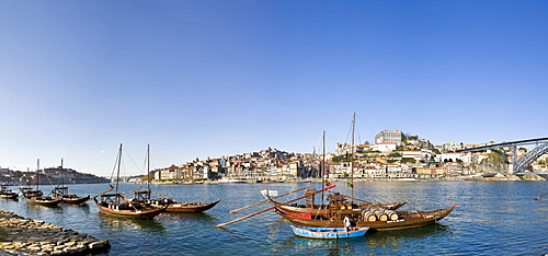 Port wine boats, at back the Ponte de Dom Luis I Bridge, Rua Diogo Leite, Rio Duoro River, Porto, UNESCO World Cultural Heritage Site, Portugal, Europe