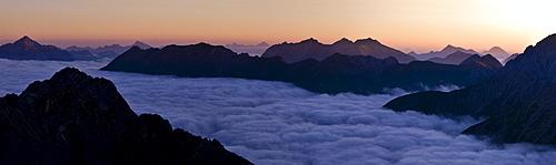 Mountain panorama at sunrise on sea of fog, Gramais, Reutte, Tyrol, Austria, Europe