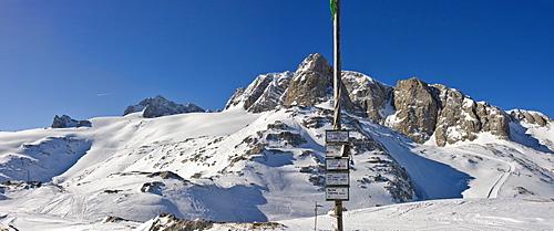 Left to right: Mts. Dirndln, Hoher Dachstein, Niederer Dachstein and, behind the directional signpost, Mt. Schoeberl, Dachstein Massif, Styria, Austria, Europe