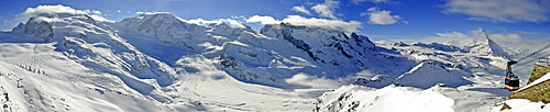 Panoramic shot, ski resort Zermatt with (from left to right) Monte Rosa, Lisskamm , Pollux, Castor, Breithorn-Massive, Matterhorn and gondola to the Stockhorn, Valais, Switzerland