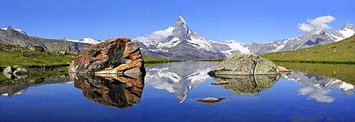 The Matterhorn is reflected in the Stellisee near Zermatt, canton Wallis, Switzerland