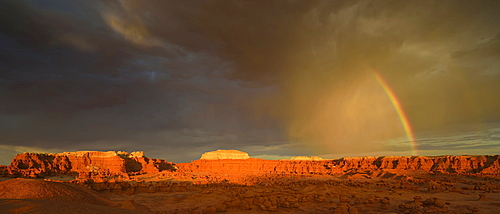 Panoramic view, rainbow during a thunderstorm, eroded entrada sandstone hoodoos and rock formations, Goblins, Goblin Valley State Park, San Rafael Reef Desert, Utah, Southwestern USA, USA