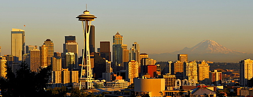 Skyline at dusk, Seattle financial district with Space Needle, Mount Rainier at back, Columbia Center, formerly Bank of America Tower, Washington Mutual Tower, Two Union Square Tower, Municipal Tower, formerly Key Tower, U.S. Bank Center, Seattle, Washing