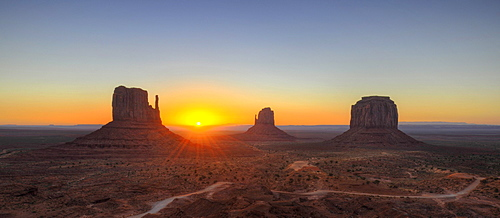 Sunrise behind mesas, West Mitten Butte, East Mitten Butte, Merrick Butte, Scenic Drive, Monument Valley, Navajo Tribal Park, Navajo Nation Reservation, Arizona, Utah, United States of America, USA