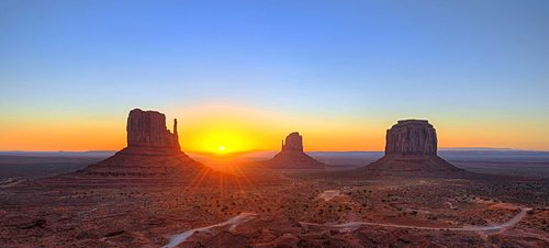 Panoramic view, sunrise at the mesas of West Mitten Butte, East Mitten Butte, Merrick Butte, Scenic Drive, Monument Valley, Navajo Tribal Park, Navajo Nation Reservation, Arizona, Utah, United States of America, USA