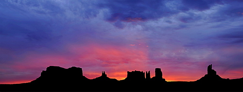 Panoramic view, sunrise, dawn, mesas of Brigham's Tomb, King on His Throne, Stagecoach, Bear and Rabbit, Castle Butte, Big Indian, Monument Valley, Navajo Tribal Park, Navajo Nation Reservation, Arizona, Utah, United States of America, USA