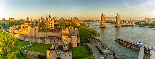 View of the Tower of London and Tower Bridge from Cheval Three Quays at sunset, London, England. Property released for viewpoint - 844-23643