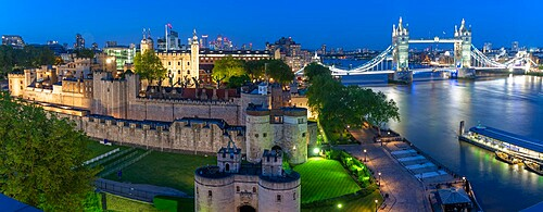 View of the Tower of London and Tower Bridge from Cheval Three Quays at dusk, London, England. Property released for viewpoint - 844-23653