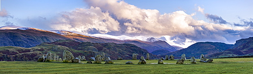 Castlerigg Stone Circle in autumn with Raven Cragg to the right and the snow topped Helvellyn mountain range in the distance, Lake District National Park, Cumbria, England, United Kingdom, Europe
