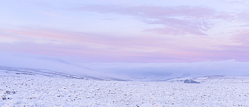 Soft pastel colours at dawn on Pockstones Moor, looking towards Appletreewick Pasture and Grimwith Reservoir, North Yorkshire, Yorkshire, England, United Kingdom, Europe