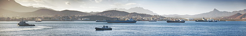 04/04/2009, Early morning, Mindelo Harbour, Tug boat, Cargo ships with mindelo and surrounding mountains, Panoramic. Mindelo, Mindelo Harbour, Sao Vicente Island. Cape Verde Islands