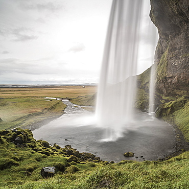 Behind Seljalandsfoss, a famous waterfall just off route 1 in South Iceland (Sudurland), Iceland, Polar Regions