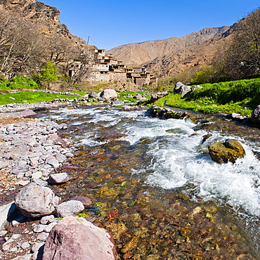 River running past Tizi n Tamatert and a Berber village, High Atlas Mountains, Morocco, North Africa, Africa