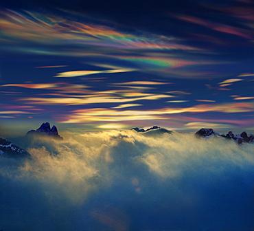 Polar stratospheric clouds above mountain peaks, Antarctic Peninsula, Antartica