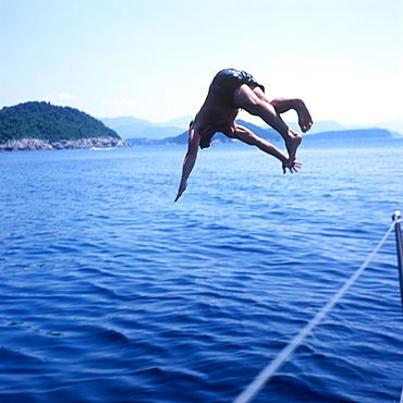 Man diving into Adriatic Sea, Dalmatia, Croatia