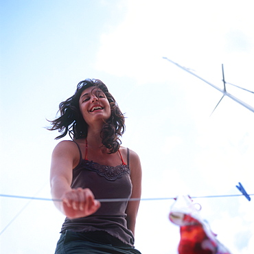Woman standing on a sailboat and smiling at camera, portrait
