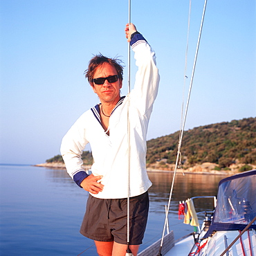 Man wearing sailor suit standing on sailboat, portrait, Adriatic Sea, Dalmatia, Croatia
