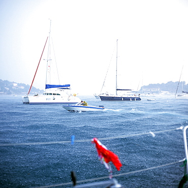 Sailboats in storm anchoring near Hvar, Dalmatia, Croatia