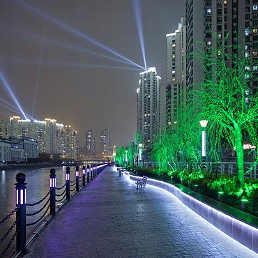 Zhongyuan Liangwancheng Community at night, big apartment compound along the Suzhou river, Shanghai, China