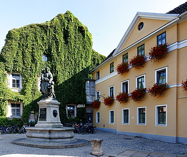 Hostel Hababusch with a statue in the foreground, Geleit Street, Weimar, Thuringia, Germany