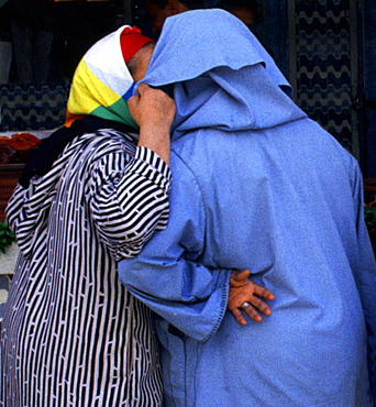 Two women talking to each other, Fes, Morocco, Africa