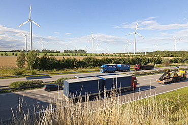 Wind turbines along the A2 Autobahn in the direction of Berlin with traffic, Magdeburg, Lower Saxony, Germany