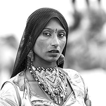 Portrait of a local tribeswoman in Sam sand dunes, near Jaisalmer, Damodara, Rajasthan, India