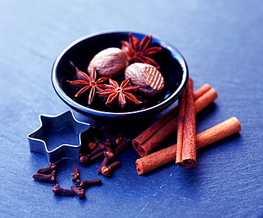 Spices in bowl, Star Anise, Pinks, Cinnamon, Nutmeg and baking-tin