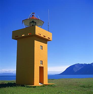 Lighthouse on the coast of the island of Flatey, north Iceland, Polar Regions