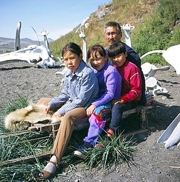 Eskimos, sledge and whale bones at Yanrakino village (population 150), Chukchi Peninsula, Russian Far East, Russia, Asia