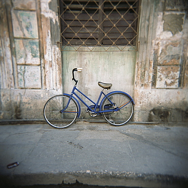 Blue bicycle against a wall, Havana Centro, Havana, Cuba, West Indies, Central America
