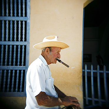 Old man in profile, smoking cigar, Trinidad, Cuba, West Indies, Central America