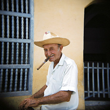 Old man smoking cigar, Trinidad, Cuba, West Indies, Central America