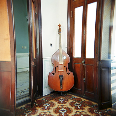 Double bass propped against a wall, Cienfuegos, Cuba, West Indies, Central America