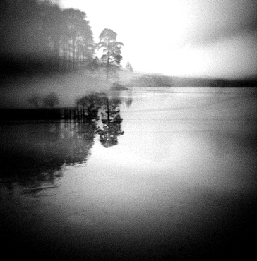 Image taken with a Holga medium format 120 film toy camera of misty view of Blea Tarn at dawn, Lake District, Cumbria, England, United Kingdom, Europe
