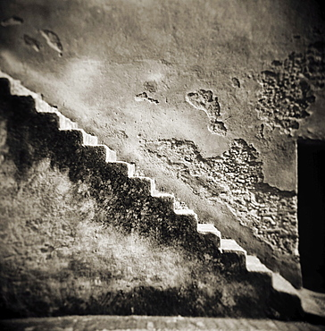 Image taken with a Holga medium format 120 film toy camera of a staircase on the outside of an old stone wall, Chefchaouen, Morocco, North Africa, Africa