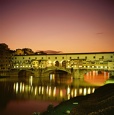 Reflections of the Ponte Vecchio dating from 1345, and the River Arno at sunset, Florence, Tuscany, Italy, Europe