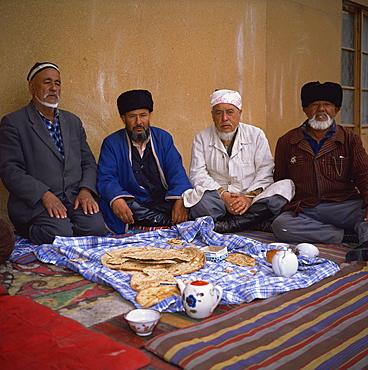 Uzbek imam and Muslims in a mosque, Khiva, Uzbekistan, Central Asia, Asia