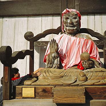 Buddhist Todai-ji Temple, image of Binzuru - touching it is supposed to cure illness, Nara, Japan